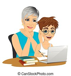 cute grandson helping grandmother to use laptop isolated on...