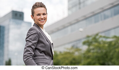 Portrait of modern business woman at the office district -...