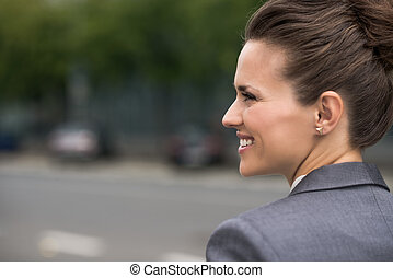 Profile portrait of smiling business woman at office...