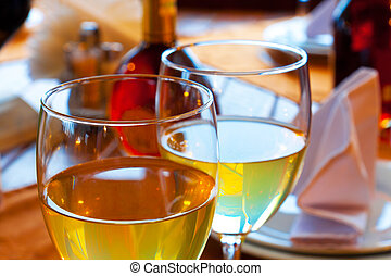Wine goblets on restaurant table. Shallow DOF