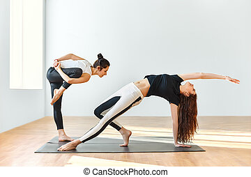 Two young women dancing in gym