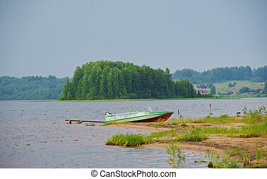 Lake Kenozero . Motor boat on the shore. Arkhangelsk region,...