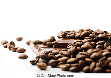 coffee beans and chocolate pieces on white background