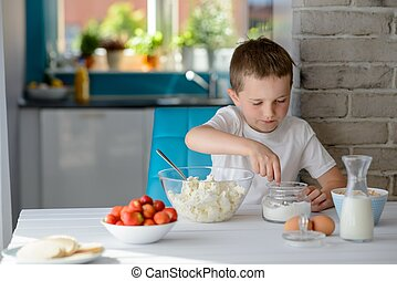 Child adding sugar to cottage cheese in a bowl - 7 year old...