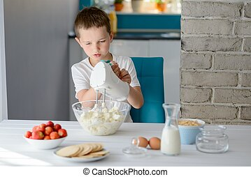 Child mixing with electric mixer white cottage cheese - 7...