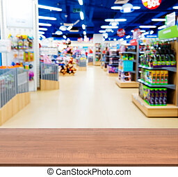 Wooden empty table in blurred kids toy shop - Wooden board...
