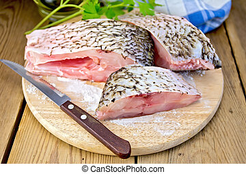 Bream raw pieces on old board - Bream raw sliced slices,...