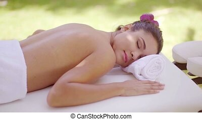 Relaxed young woman at an outdoor spa - Relaxed attractive...