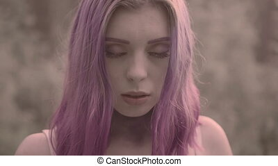 Woman with purple hair in forest - Close up of pretty woman...