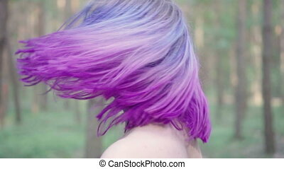 Woman purple hair shake - Close up of pretty woman face...