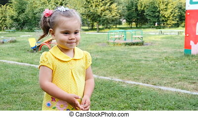 Little girl has fun in the park