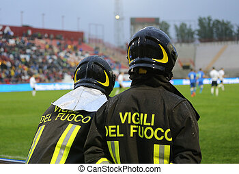 two Italian firefighters with uniform with the inscription...