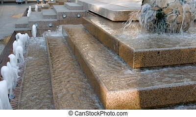 City fountain in sunny weather - City fountain, water flows...