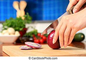 Female chopping food ingredients. - Female chopping food...
