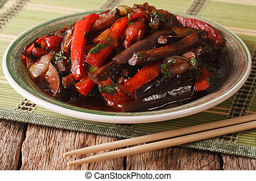 Eggplant Stir-Fry from Asian-style close-up on a plate....