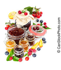Different berry jam in glass jar