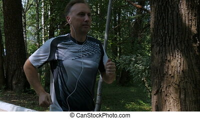 The man likes to run in the park, for a healthy lifestyle,...