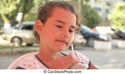 girl teen drinking milkshake holiday outdoor cafe summer...