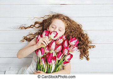 Little Girl smell of tulips and closed her eyes - Curly Girl...