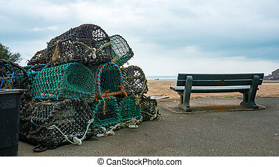Lobster pots stacked ontop of each other near Bude on the...