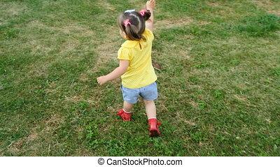 Little girl is running in the park 4K ultrahd video