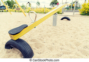 close up of swing or teeterboard on playground - childhood,...