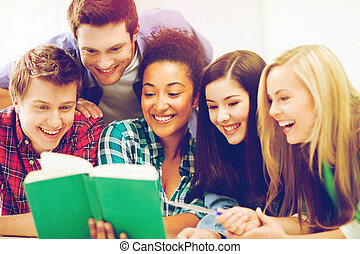 students reading book at school - education concept - group...