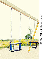 baby swing on playground outdoors - childhood, equipment and...