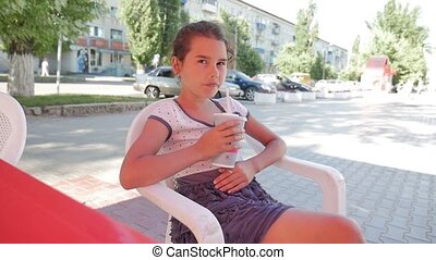 girl teen drinking milkshake outdoor cafe summer holiday...