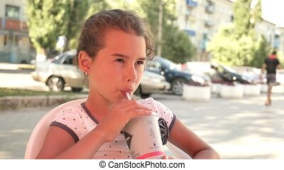 girl teen drinking outdoor milkshake holiday cafe summer vacation slow motion video