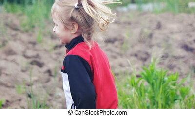 Girl running in garden - Little girl running older sister...