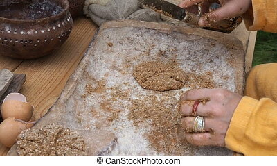 Dolly shot of woman making bread