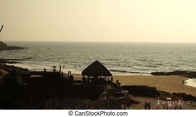 Sea. Beach. People. Gazebo - People relaxing on the beach on...