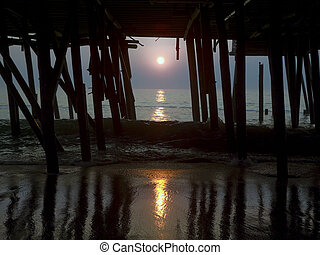 Sunrise at Ocean Old Pier - The Sunset viewed beneath a...