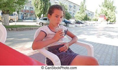 teen girl drinking milkshake at outdoor cafe summer holiday...