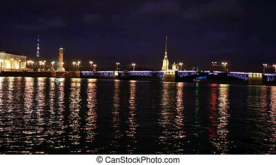 Night view of the University embankment of St. Petersburg through the Neva River- Peter and Paul fortress Palace bridge Vasilievsky island.