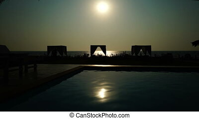 Sea. Sun. Reflection. Swimming pool.