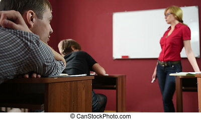 female teacher giving a lecture at the University -...