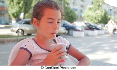 girl teen drinking milkshake outdoor cafe holiday summer vacation slow motion video