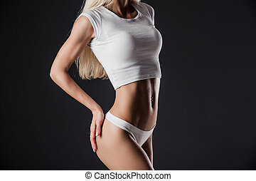 health and beauty - woman in white underwear showing slimming concept