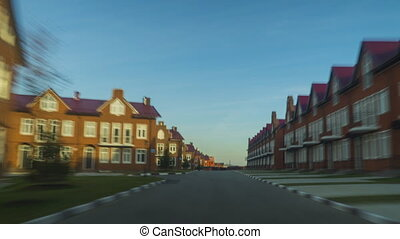 Red brick townhouses sunny day hyperlapse clip