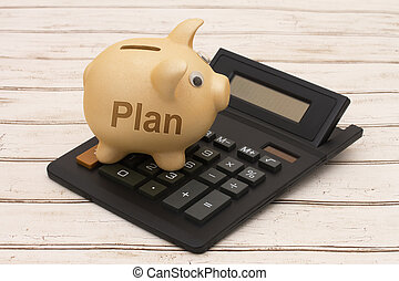 Your Savings Plan, A golden piggy bank and calculator on a...