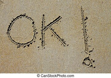 ok word spell written on beach wet sand positive summer...