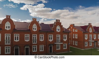 Beautiful clouds over red brick town houses clip