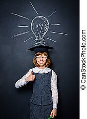 discovery - Educational concept. Smiling schoolgirl standing...