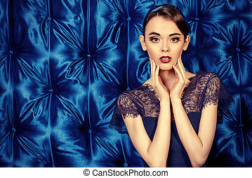 belle style - Portrait of a pretty young woman wearing blue...