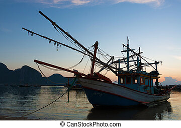 fishing trawler - Old wooden fishing boat anchored at the...