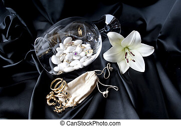 Jewelry and other precious stones on black background fabric