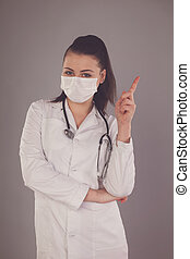 Warning od nurse - Nurse in white robe is against grey...