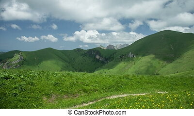 Mountain under the blue sky with clouds. Caucasus, Russia